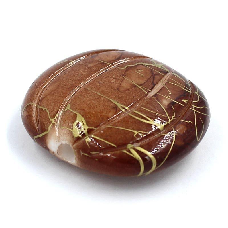 Abalorio calabaza de resina en color marrón
