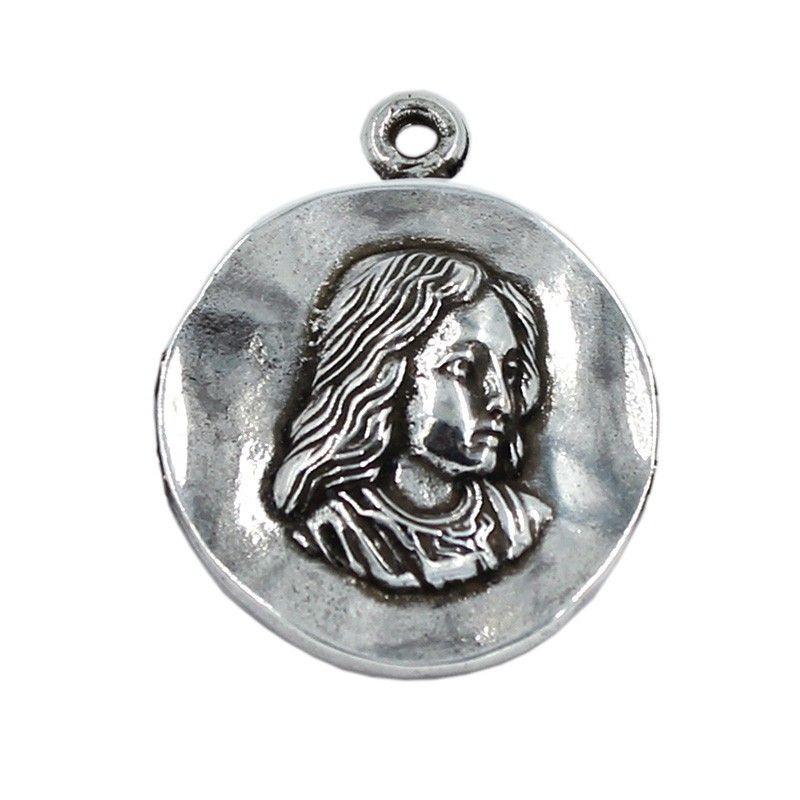 Medalla Virgen Niña de zamak y plata
