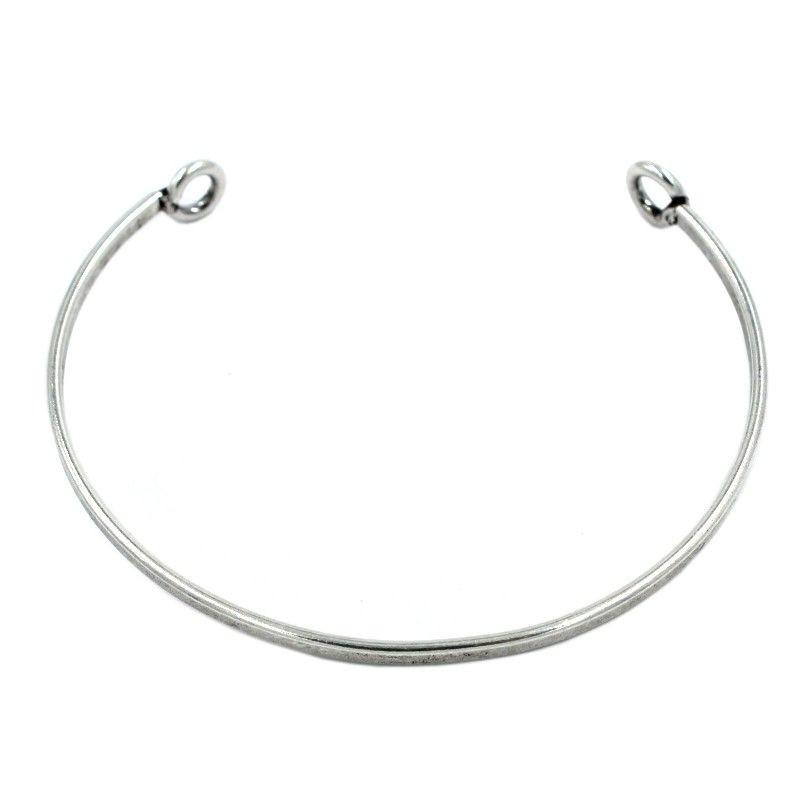 Bracelet rigide avec des anneaux de laiton plaqué argent